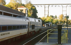 Amtrak & Metro-North Railroad passenger station with a MNRR commuter train perparing to depart with the locomotive pushing as it heads to New York City from Poughkeepsie, New York, Fall 2002