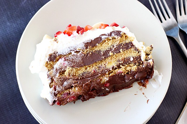 Chocolate Banana Strawberry Ice Box Cake on a white plate with a fork.