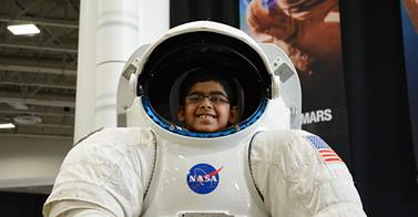 Boy in Space Suit at USA Science & Engineering Festival