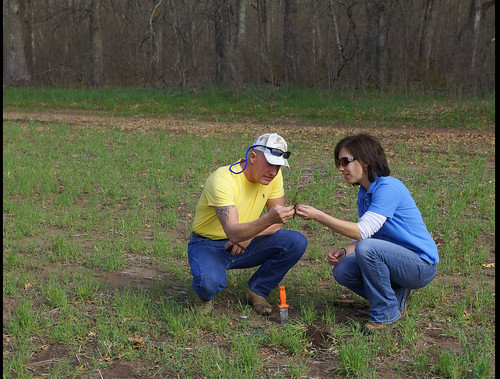 Keith Johnson checks out NRCS' Web Soil Survey app while Deb Hermel, North Branch Minnesota District Conservationist, pulls a soil sample.