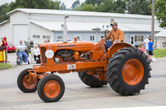 tractor pulling(0.0), automobile(1.0), wheel(1.0), vehicle(1.0), agricultural machinery(1.0), land vehicle(1.0), tractor(1.0),