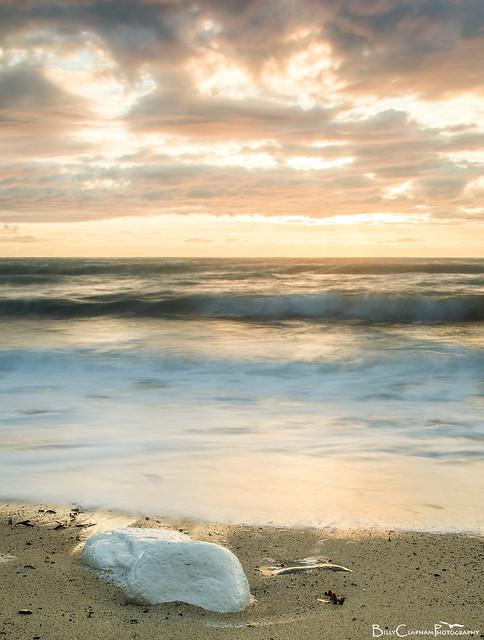 golden light waves white surf blue