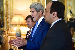 U.S. Secretary of State John Kerry, flanked by Turkish Foreign Minister Ahmet Davutoglu and Qatari Foreign Minister Khalid Al Attiyah, addresses reporters at the U.S. Ambassador's Residence in Paris, France, on July 26, 2014, before a trilateral meeting focused on reaching a cease-fire in the fighting between Israel and Hamas in the Gaza Strip. [State Department photo/ Public Domain]