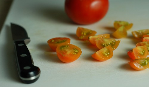 Slicing up fresh-picked Sun Gold tomatoes by Eve Fox, The Garden of Eating, copyright 2014