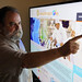 University of Hawaiʻi Community Colleges Associate Vice President for Academic Affairs Peter Quigley demonstrating the Sector Mapping Tool, which he played a key role in developing. The Sector Mapping Tool uses data visualization and heat mapping to align Hawai'i's economic and workforce needs with academic offerings and production at UH, making a clear connection between jobs and academic programs.