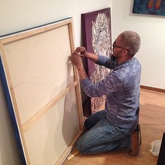 "artist and curator @robertlewisclark hanging work for our show ""home is where the art is"" on Friday!"