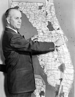 Florida Comptroller measuring a map-Tallahassee