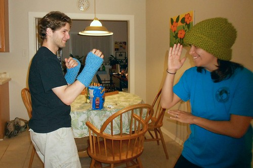 Katie and Aaron Sparring in my Knitting Samples