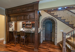 Wet bar and wine cellar in the walkout basement of the Jasper Hill house design #5020