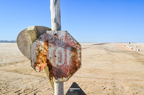 Rusty stop sign on the Namib coast