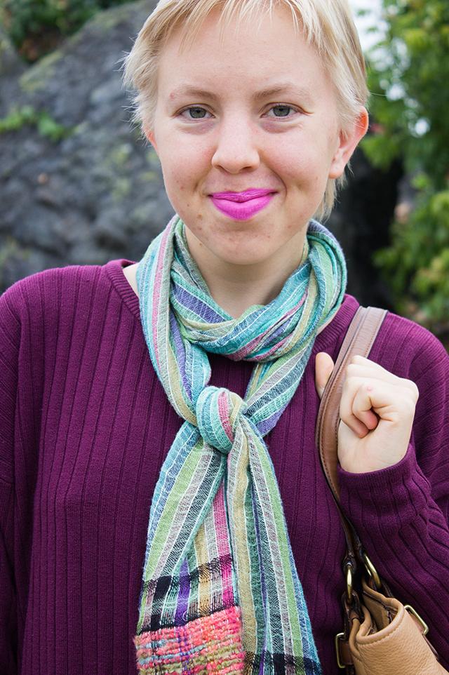 bright pink lipstick, green scarf, plum purple sweater