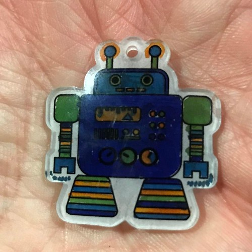 I've got you now robot. Shrink Art. Colored by me while the boys were coloring their own. Who remembers Shrinky Dinks? . . . . . #inthepalmofmyhand #robot #art #shrinkydinks