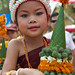 laos-luang-prabang-laos-new-year-phi-mai-lao-little-girl-in-traditional-dress-holds-orange-flower-offering-tiger trail-cyril-eberle CEB-5984.jpg