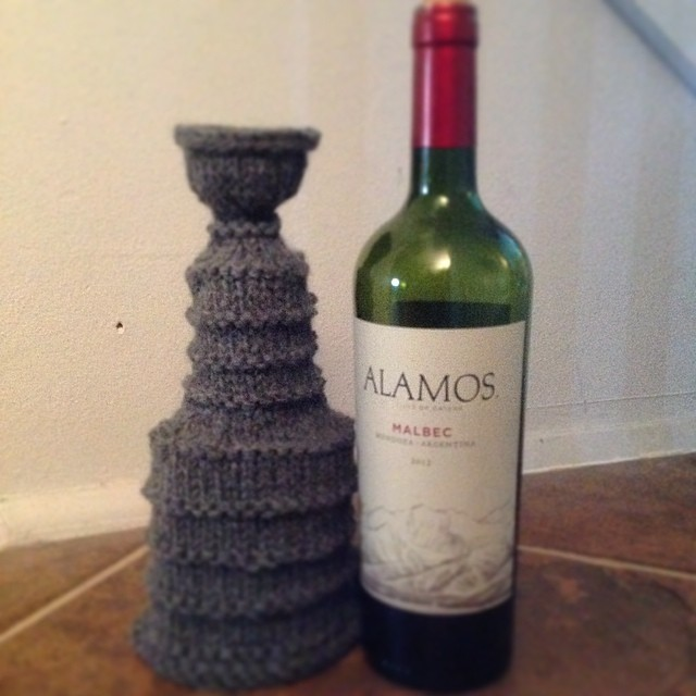 My knitted Stanley Cup waiting in the wings for my beloved #lakings #knit Note: I have red wine to help me!