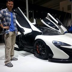 automobile(1.0), automotive exterior(1.0), exhibition(1.0), wheel(1.0), vehicle(1.0), automotive design(1.0), auto show(1.0), mclaren automotive(1.0), land vehicle(1.0), luxury vehicle(1.0), supercar(1.0), sports car(1.0),
