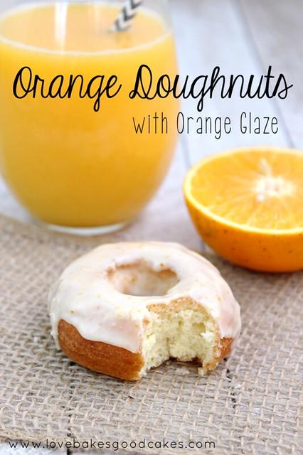 Orange Doughnut with Orange Glaze and a glass of orange juice and an orange slice.
