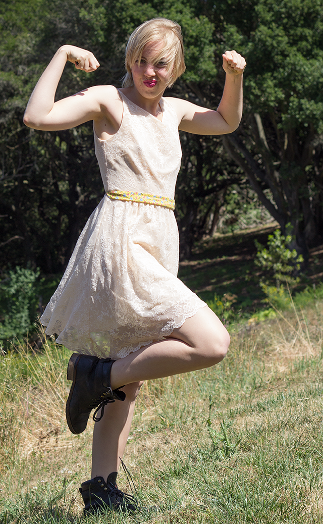 silly pose, cream lace dress blowing in the wind, bulky black leather ankle boots