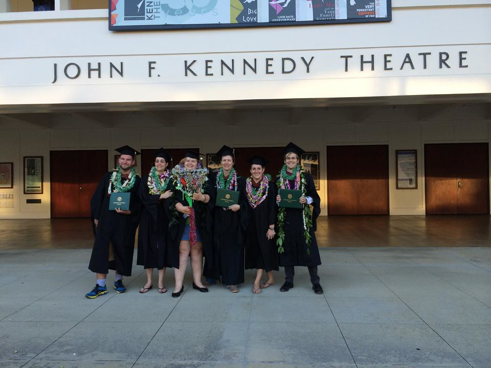 <p>UH Manoa Department of Theatre and Dance graduate students receiving their MFA's in theatre in front of the John F. Kennedy Theatre after the UH Manoa commencement ceremony.</p>