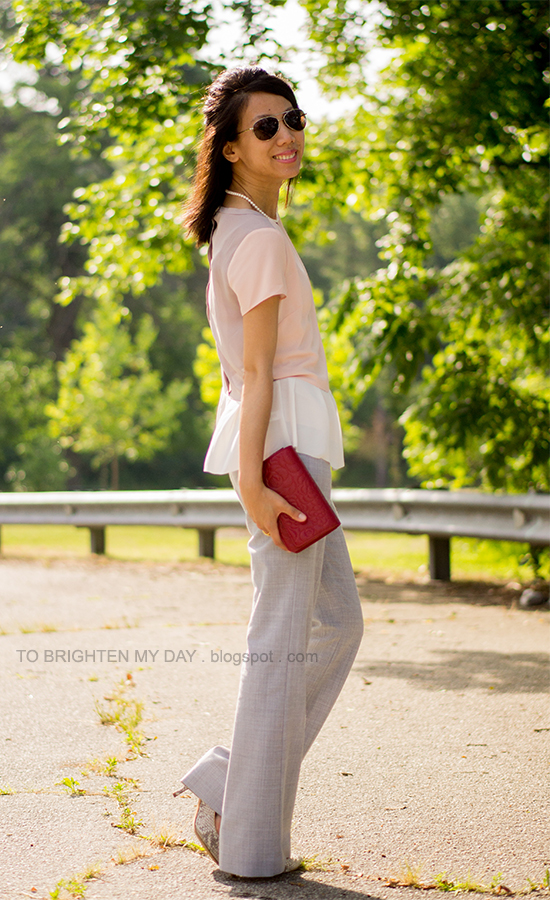 colorblock peplum top, gray trousers, red clutch