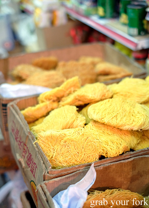Cakes of dried egg noodles at the Gage Street market in the Central district, Hong Kong