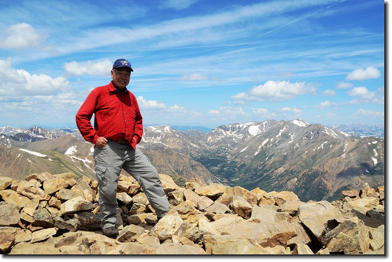 Me on the summit of Mt. Elbert, background is Mt. Massive