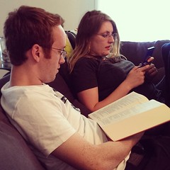 He's reading Shakespeare.  She's playing the Gameboy. Match. Made. In. Heaven. #mymarriedkids #son2 #Sabbath #chillin #reading #videogames #family #peoplemattermost #ayearoffaces #365project #20140630