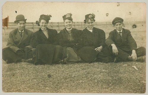 Five sitting on the grass