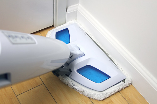 Cleaning around corners on wood floors with steam mop | by yourbestdigs
