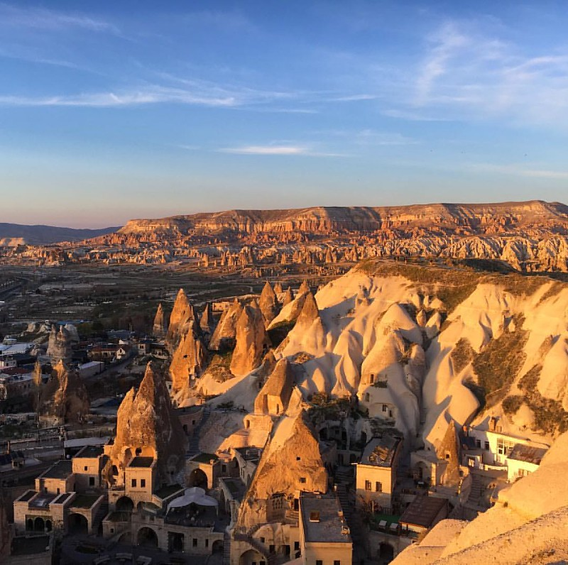 Sunset at #cappadocia. All the valley and fairy chimneys are painted with color of red and gold. ☀️#turkey #goreme