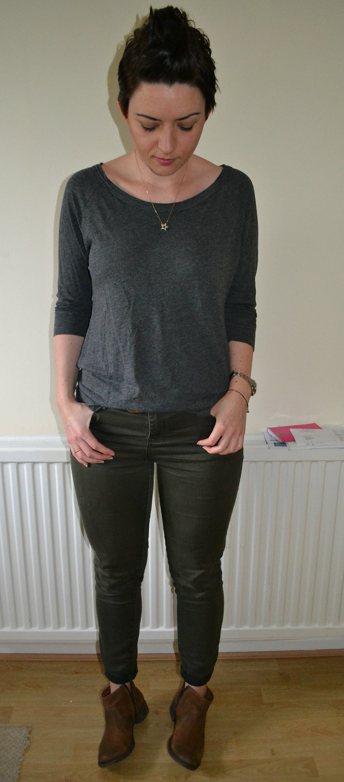 grey top and green jeans