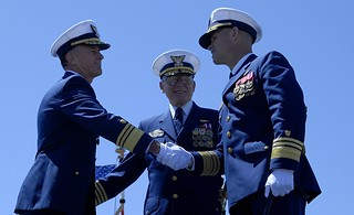 Vice Adm. Paul F. Zukunft, left, and Admiral Robert J. Papp, center, congratulate Vice Adm. Charles W. Ray on his new position as the Commander of Pacific Area at the Change of Command Ceremony held on Coast Guard Island in Alameda, Calif., April 22, 2014. The ceremony, a time-honored military tradition, formally marked the transition of command from Zukunft to Ray. U.S. Coast Guard photo by Petty Officer 3rd Class Loumania Stewart