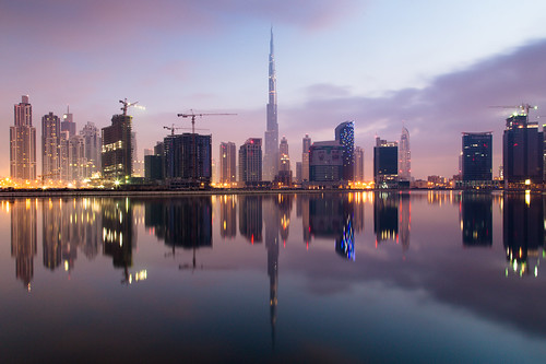 lake building tower water clouds skyscraper sunrise dawn bay office construction downtown dubai apartment business khalifa burj supertall