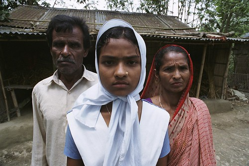 Young student with her parents | by World Bank Photo Collection