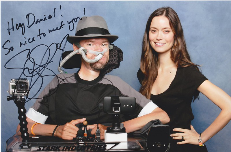 Autographed photo of Summer Glau standing next to Daniel Baker