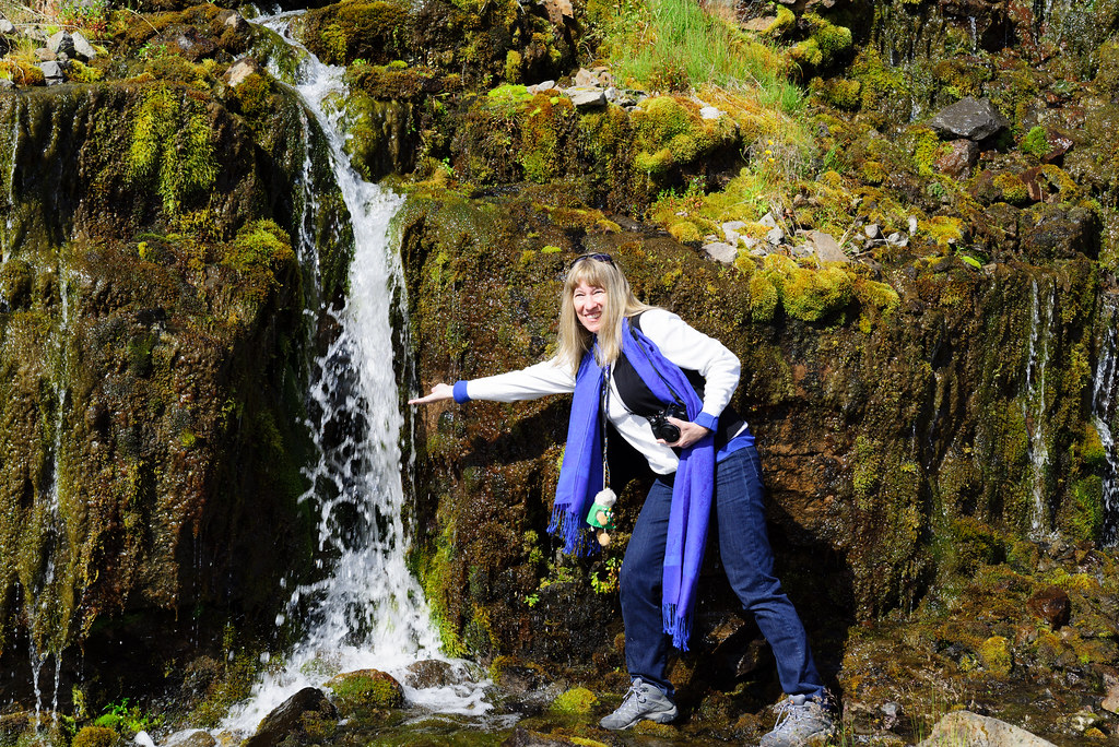 Cynthia Drinks From A Waterfall