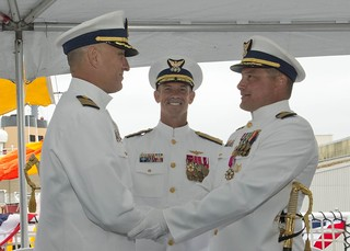 Vice Adm. Charles Ray, commander of Coast Guard Pacific Area, stands with Capt. George Pellissier (left), former commanding officer of Coast Guard Cutter Polar Star, and Capt. Matthew Walker, commanding officer of Coast Guard Cutter Polar Star, during a change-of-command ceremony aboard the Polar Star on Base Seattle, after Walker assumed command from Pellissier, July 17, 2014. Capt. Walker is reporting from the Afloat Training Group San Diego where he served as the Coast Guard liaison officer. U.S. Coast Guard photo by Petty Officer 3rd Class Jordan Akiyama.