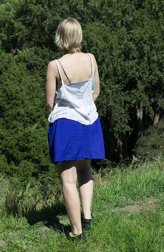 summery outfit: floaty white tank top, short blue skirt