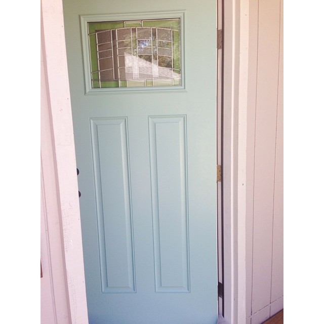 The front of the door is painted! Benjamin Moore's St. Lucia Teal #lovehome #diy