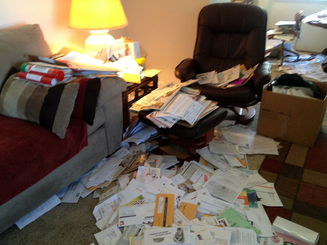 Living room covered in junk mail