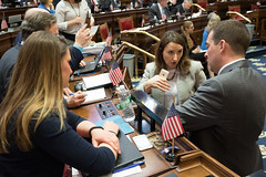 Rep. Rebimbas speaks with Rep. Stephanie Cummings and Rep. Stafstrom on the floor of the House during a recent legislative session.