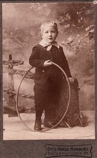 Portrait of a young boy with a hoop by Otto Haase (undated)