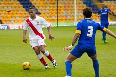 women's football(0.0), soccer player(1.0), football player(1.0), ball(1.0), sport venue(1.0), soccer kick(1.0), kick(1.0), sports(1.0), competition event(1.0), tackle(1.0), player(1.0), football(1.0), stadium(1.0), ball(1.0), team(1.0),