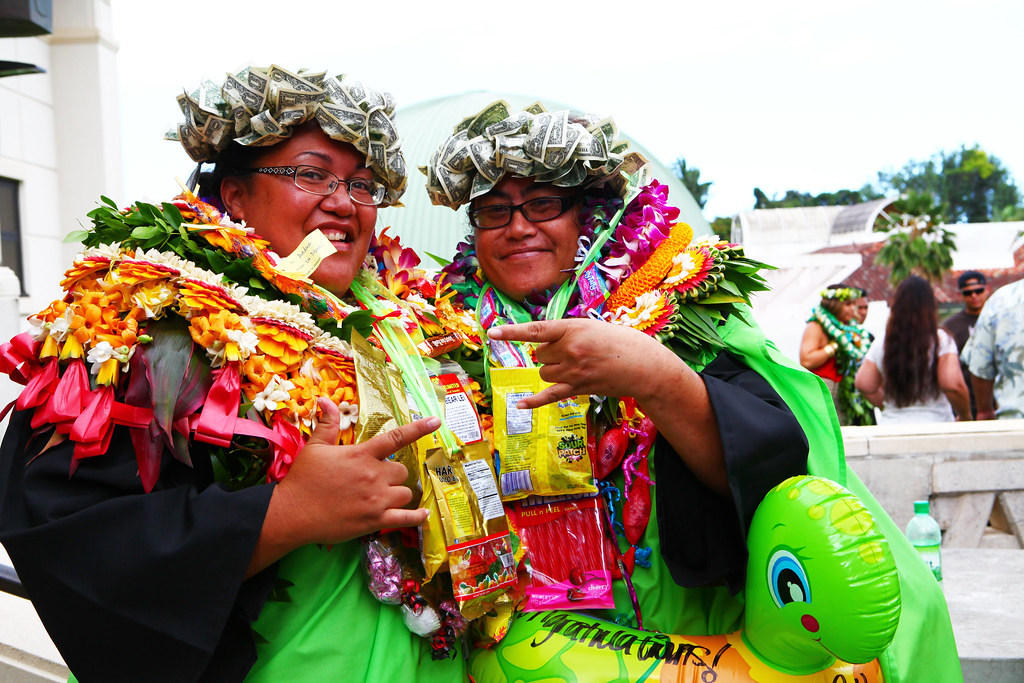 """<p>Windward Community College graduates foresee a favorable future sporting their """"green"""" haku lei at Windward CC's commencement ceremony at the Paliku Theatre on May 17, 2014. Photo by Bonnie Beatson<br /> <br /> For more photos go to <a href=""""https://www.facebook.com/buddy.aloha/media_set?set=a.597700886995993.1073741831.100002682609200"""" rel=""""nofollow"""">www.facebook.com/buddy.aloha/media_set?set=a.597700886995...</a></p>"""