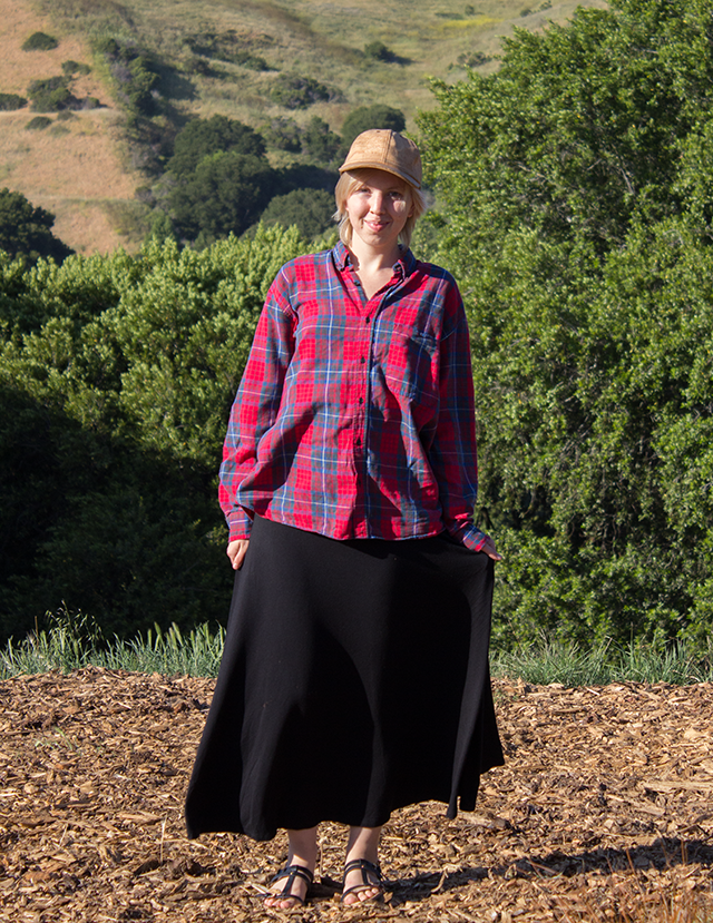 cork baseball hat, red plaid lumberjack shirt, stretchy black maxi skirt