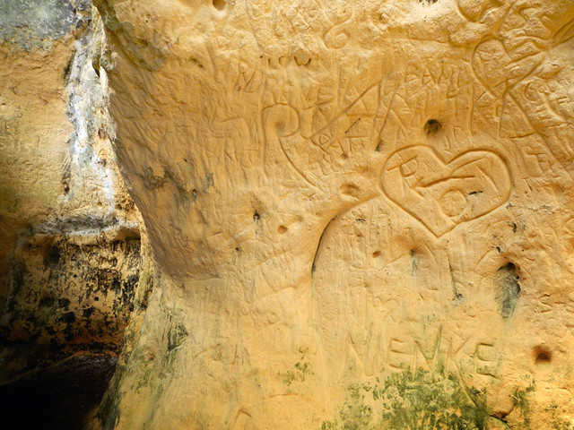 Graffiti Carved into the Soft Marl wallsin the Maastricht Cave Tour