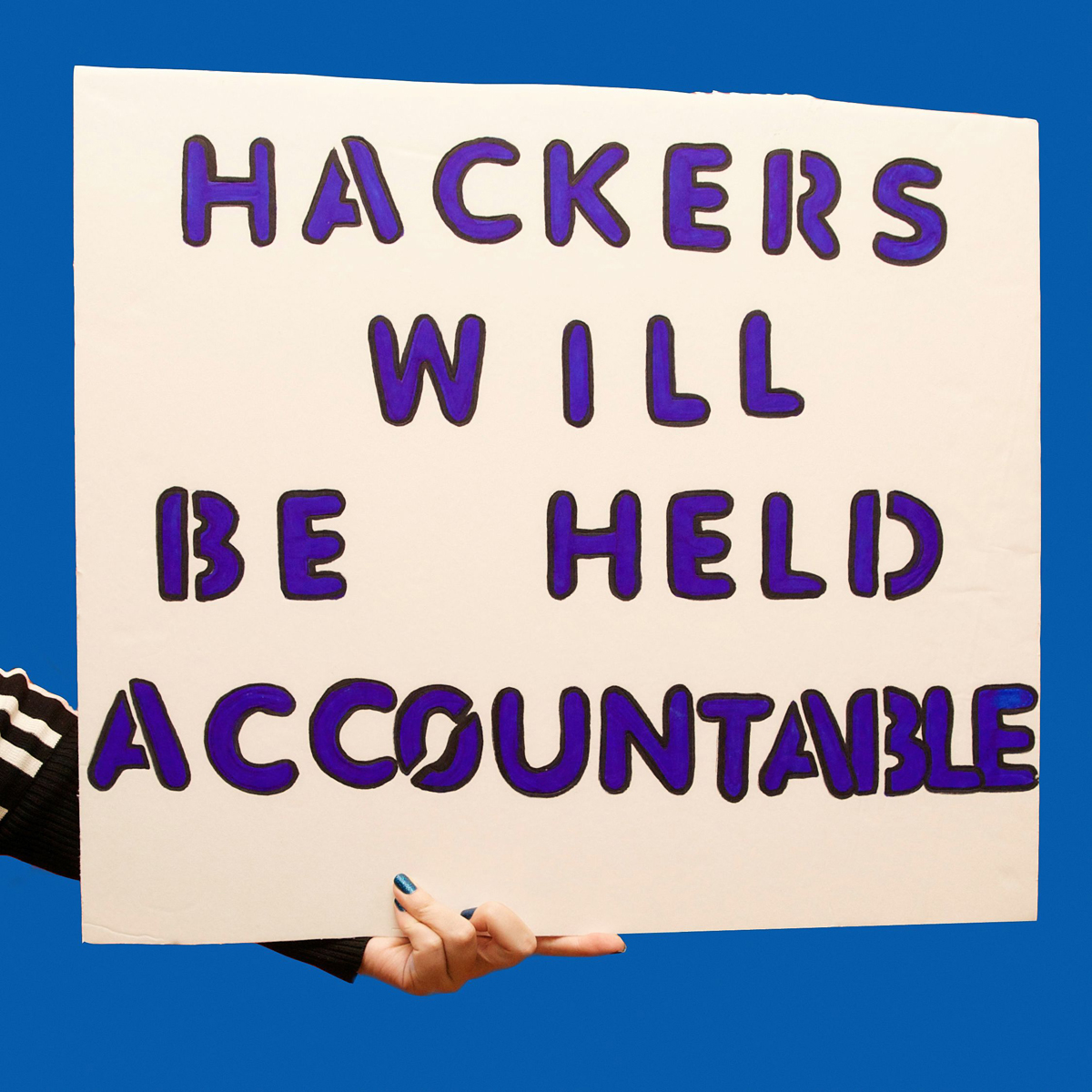 45 Protest Signs_Brandon and Olivia Locher_24_hackers will be held accountable