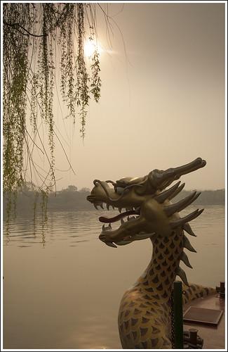 beihai park beijing chinese china dragon boat tourism tourists sun sunrise dawn lake boating