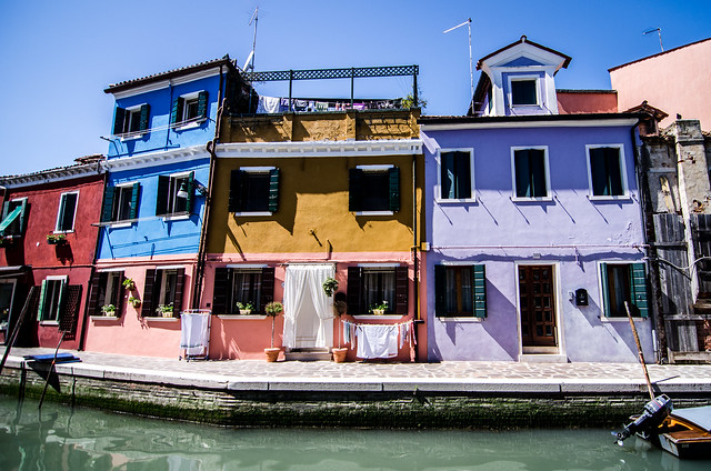 Painted houses line the canals of Burano, a short boat ride away from Venice, Italy.