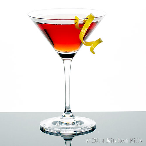 Dubonnet Cocktail in cocktail glass with lemon twist garnish
