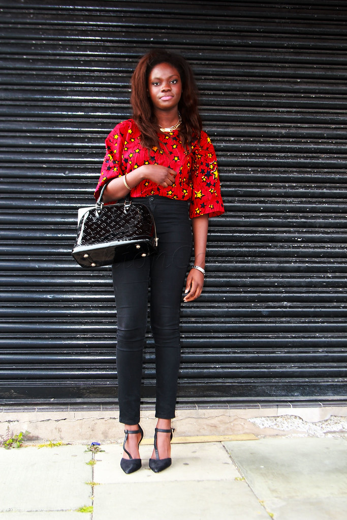 kitenge-blouse-top-with-black-jeans, african style shirts, chitenge blouse, chitenge top, african vitenge designs, african wear designs for ladies 2014, african wear new style kitenge, african wear office styles, african wear styles outfit, ankara/kitenge designs, ankara 2014 styles, ankara african wear design, ankara chic new trend 2014, ankara dinner styles, ankara fashion styles pictures